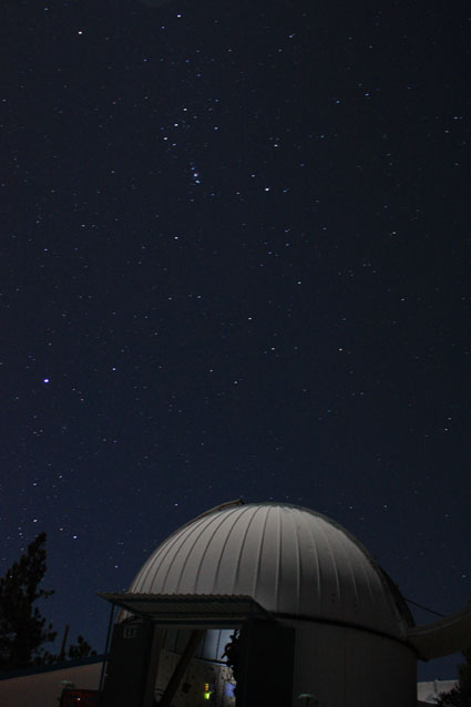 Orion is clearly visible in this 15 second exposure shot at 21mm, f/4.0. The glow inside the observatory os from the PICO laptop.